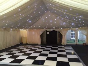Ivory LED starlight cloth above dance floor