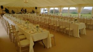Wedding reception with long tables in Vale of Glamorgan