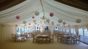 Wedding reception showing hanging lanterns